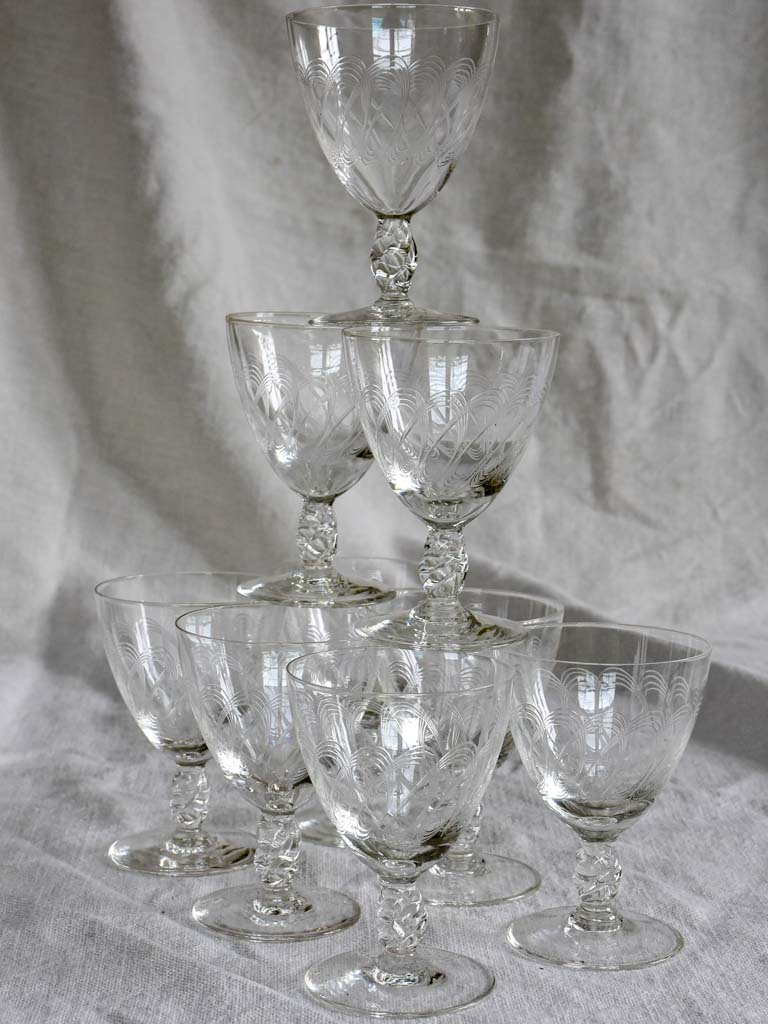 Nine mid-century white wine glasses with pretty engraving