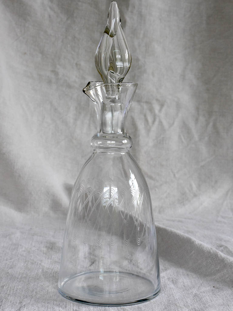 Mid century carafe with engraving and twisted stopper