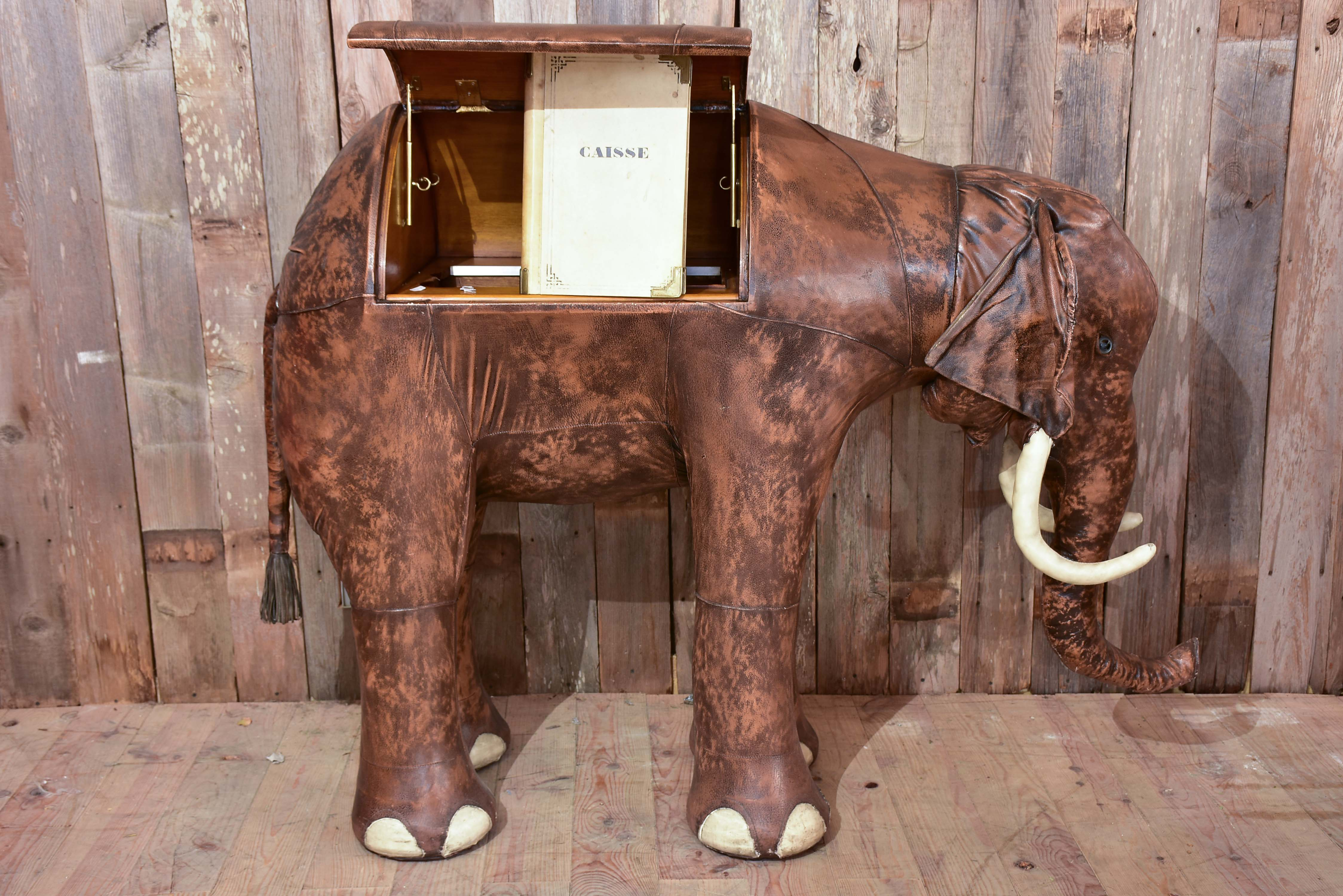 Vintage elephant in leather with hidden bar