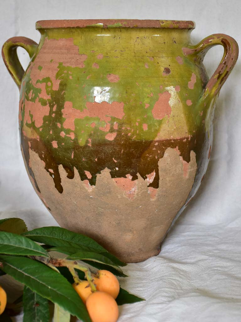 Very large antique French confit pot with fatigued green glaze 13""