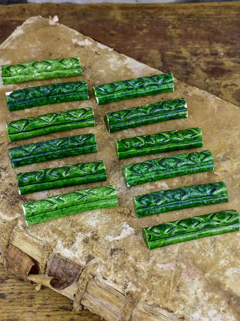 Set of 12 vintage ceramic knife rests with green glaze