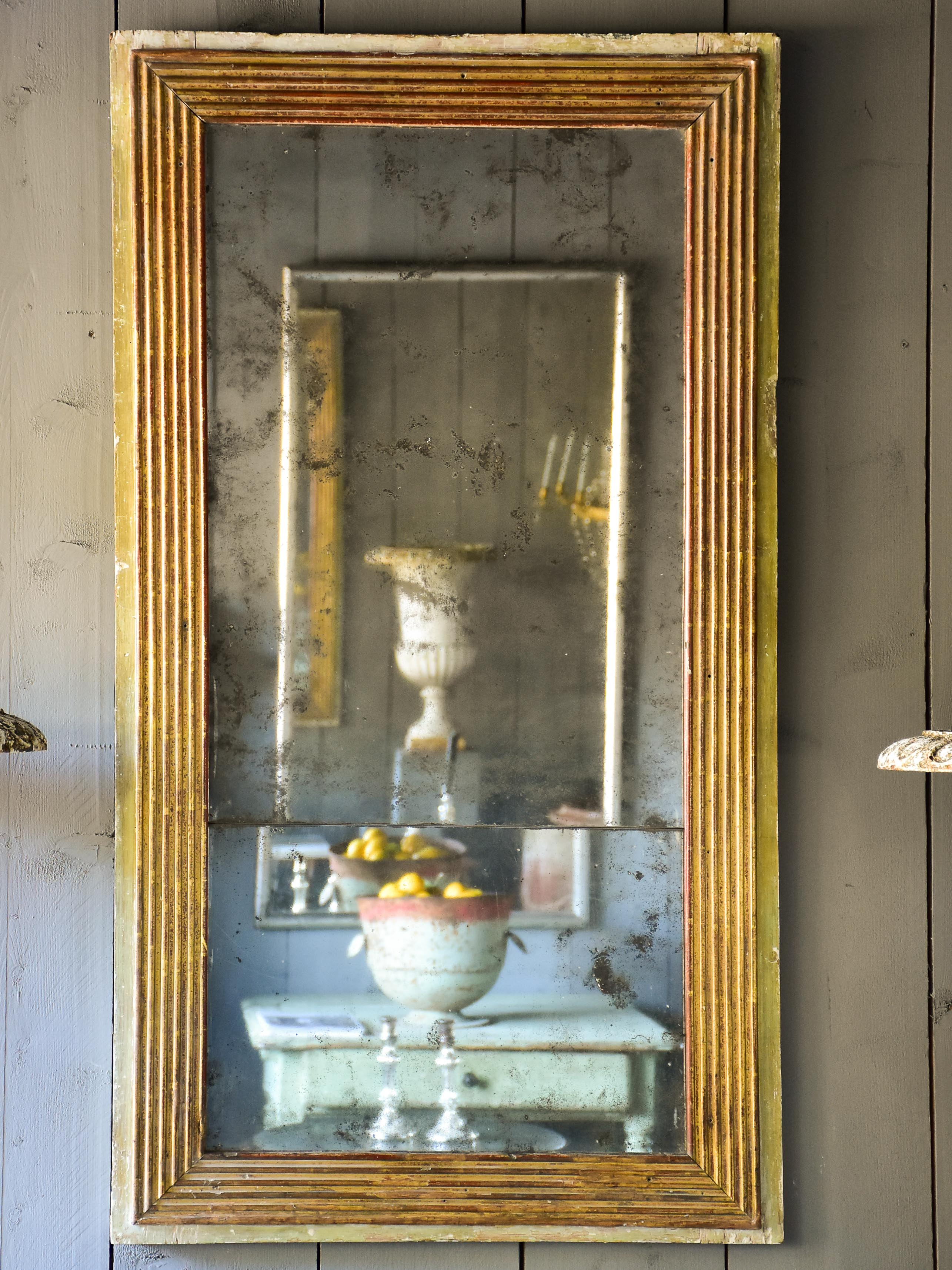 Late 18th century Louis XVI mirror with paneled glass