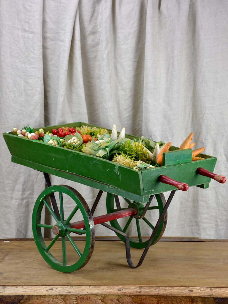 French children's toy wheelbarrow with handmade fruit and vegetables