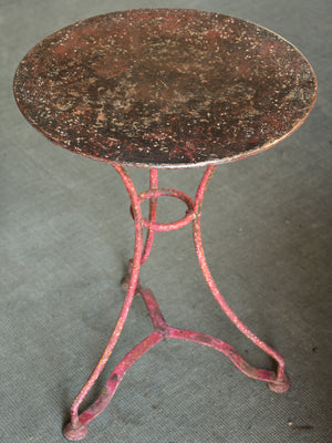 Round French garden table with red patina