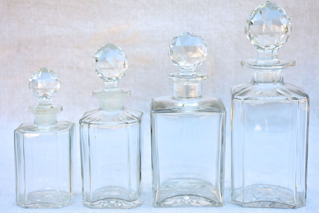 Four 1920's Baccarat perfume flasks