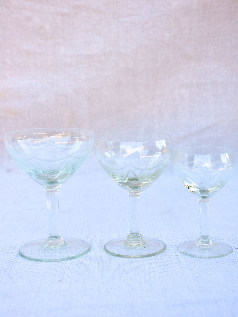 Set of antique French crystal wine and digestif glasses with pretty engravings