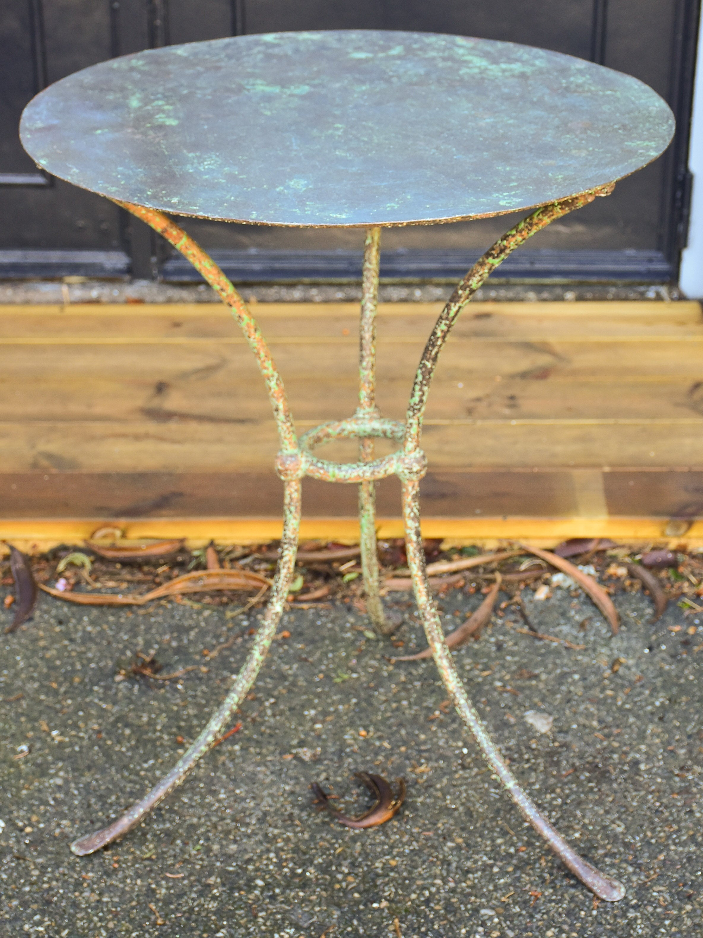 Round French garden table with green patina