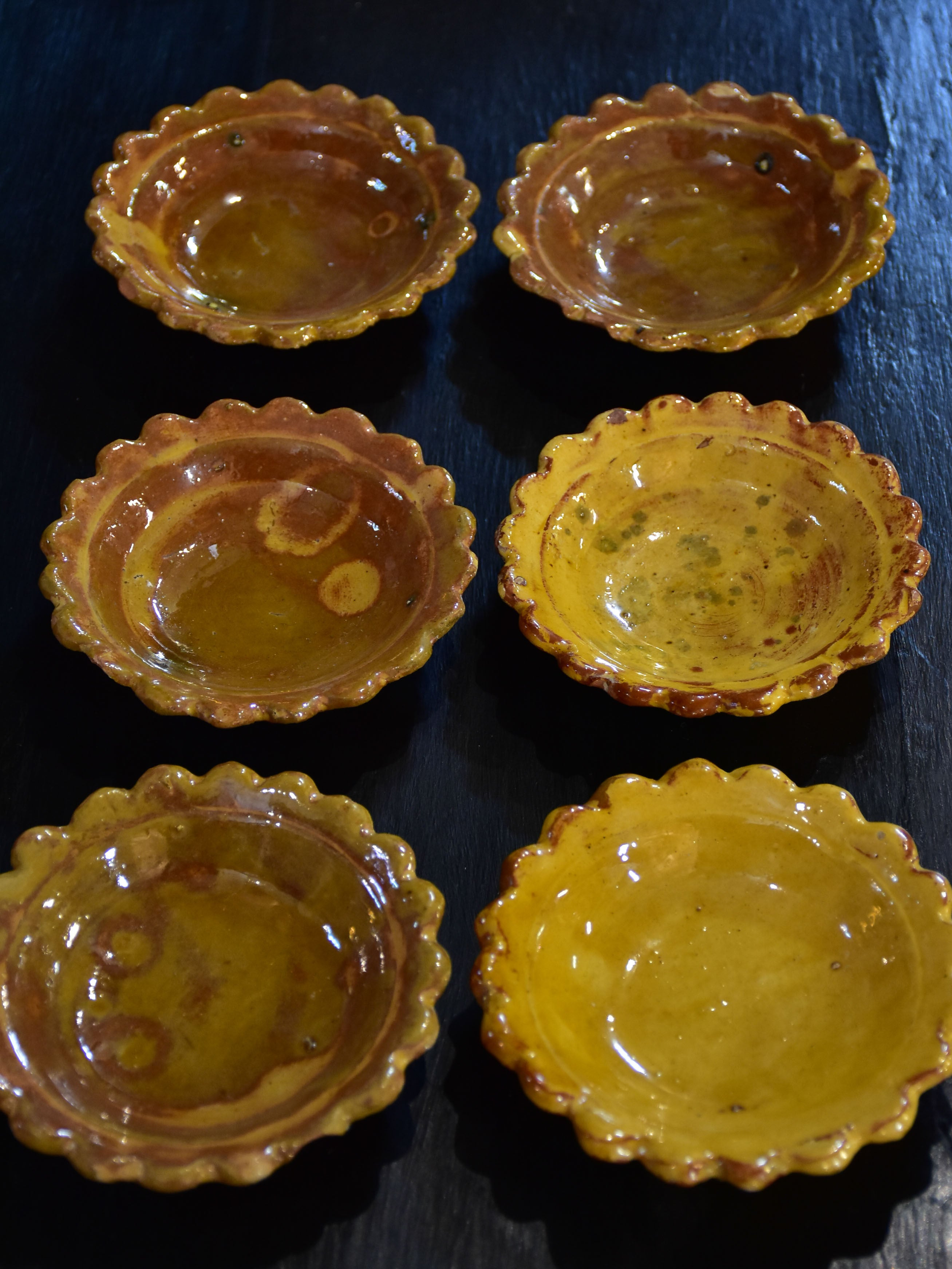 Set of six yellow glazed Provencal earthenware sauce bowls
