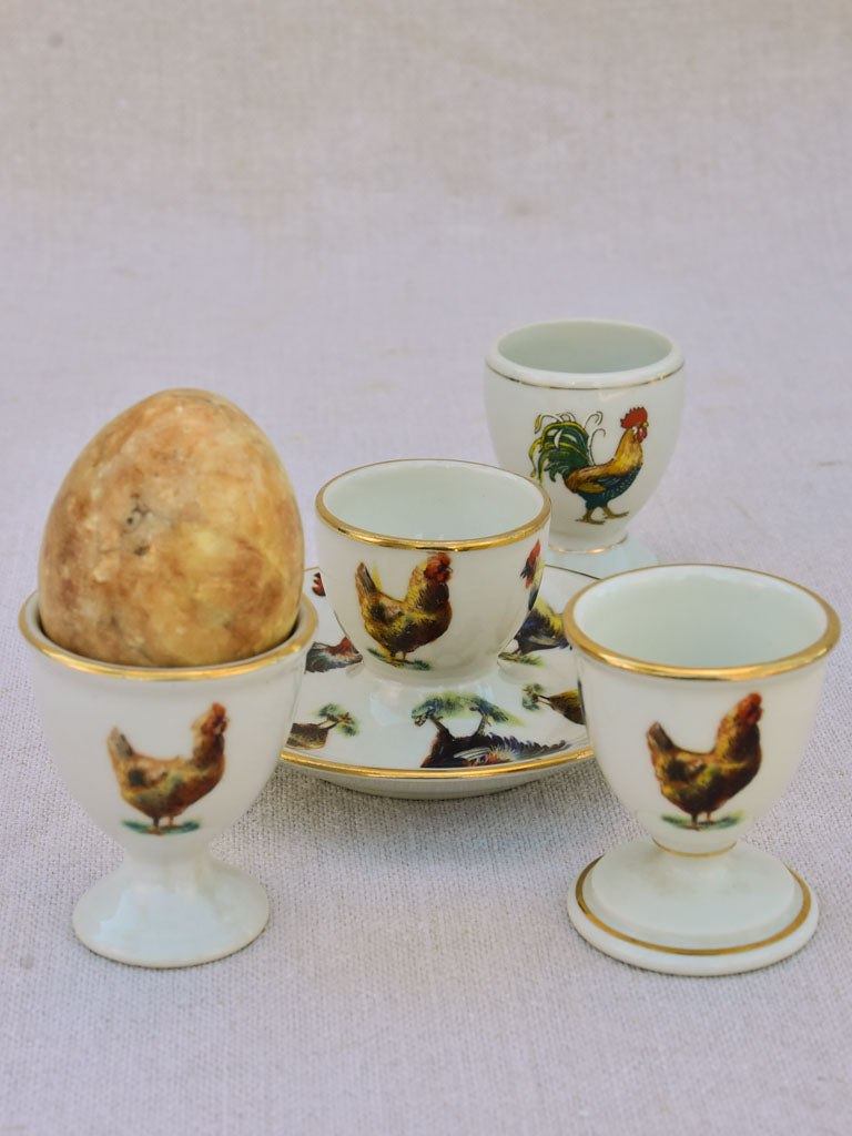 Four 1920's French porcelain egg cups with chicken and rooster transfers