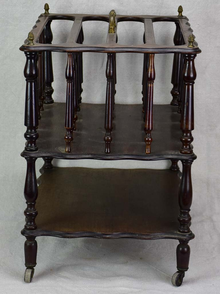 Antique French magazine rack on casters