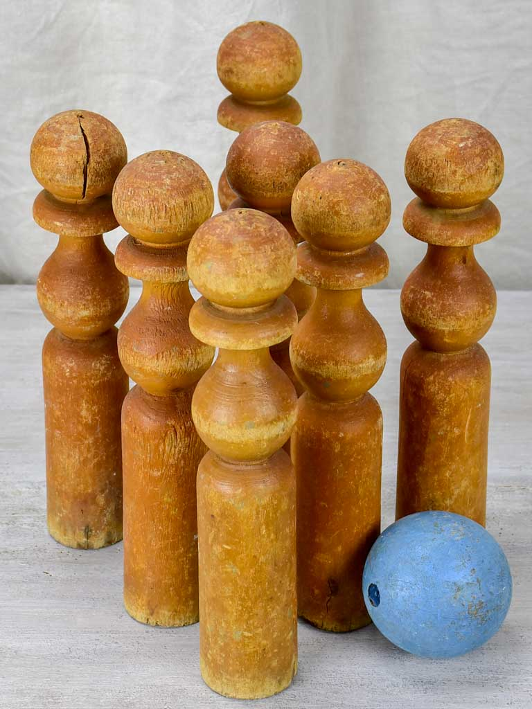 Set of 7 antique French wooden skittles and wooden blue ball