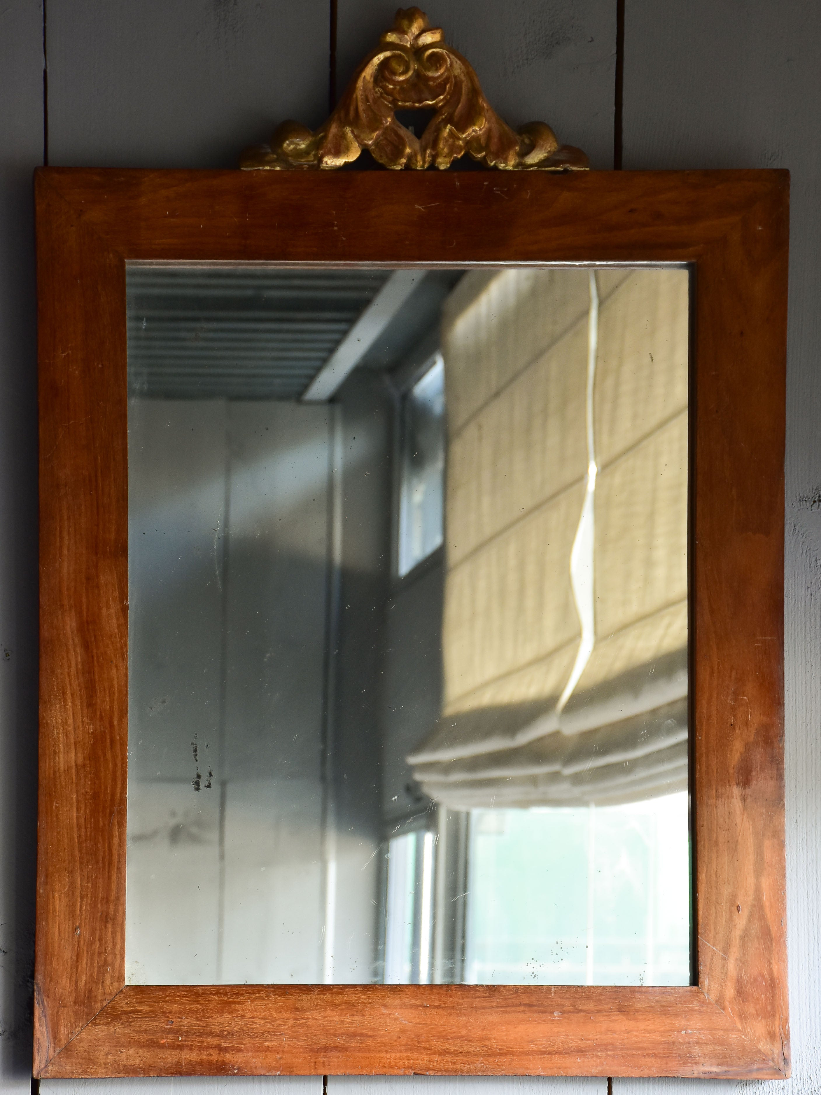 Pair of antique Italian mirrors with mahogany frames and gilded crests 23 ¼'' x 32 ¾''