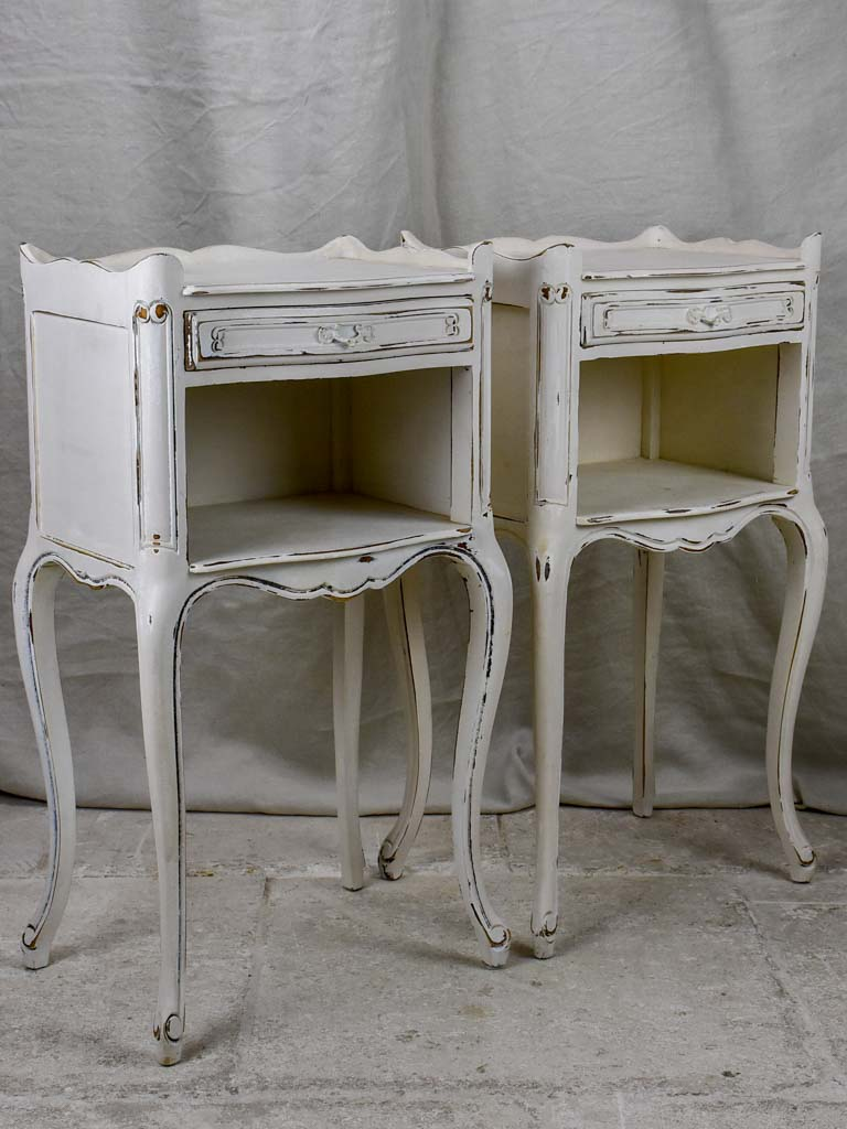 Pair of vintage French nightstands with white patina
