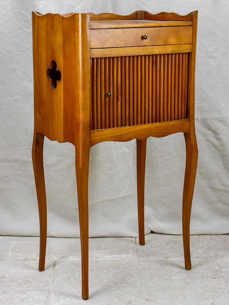 Mid century French nightstand in cherry wood with concertina door