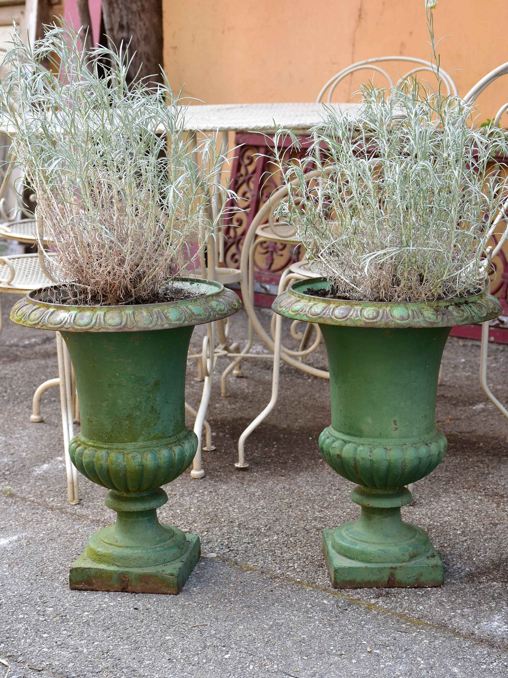 Pair of green cast-iron Medici garden urns