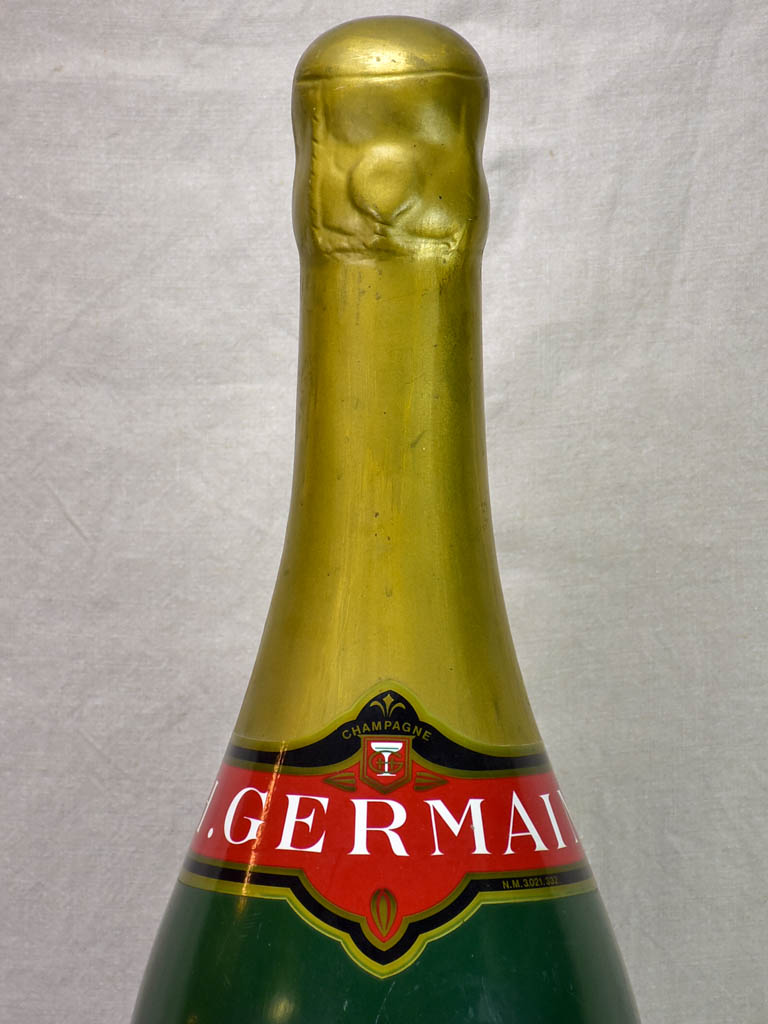 Collection of four oversize advertising champagne bottles - 1950s