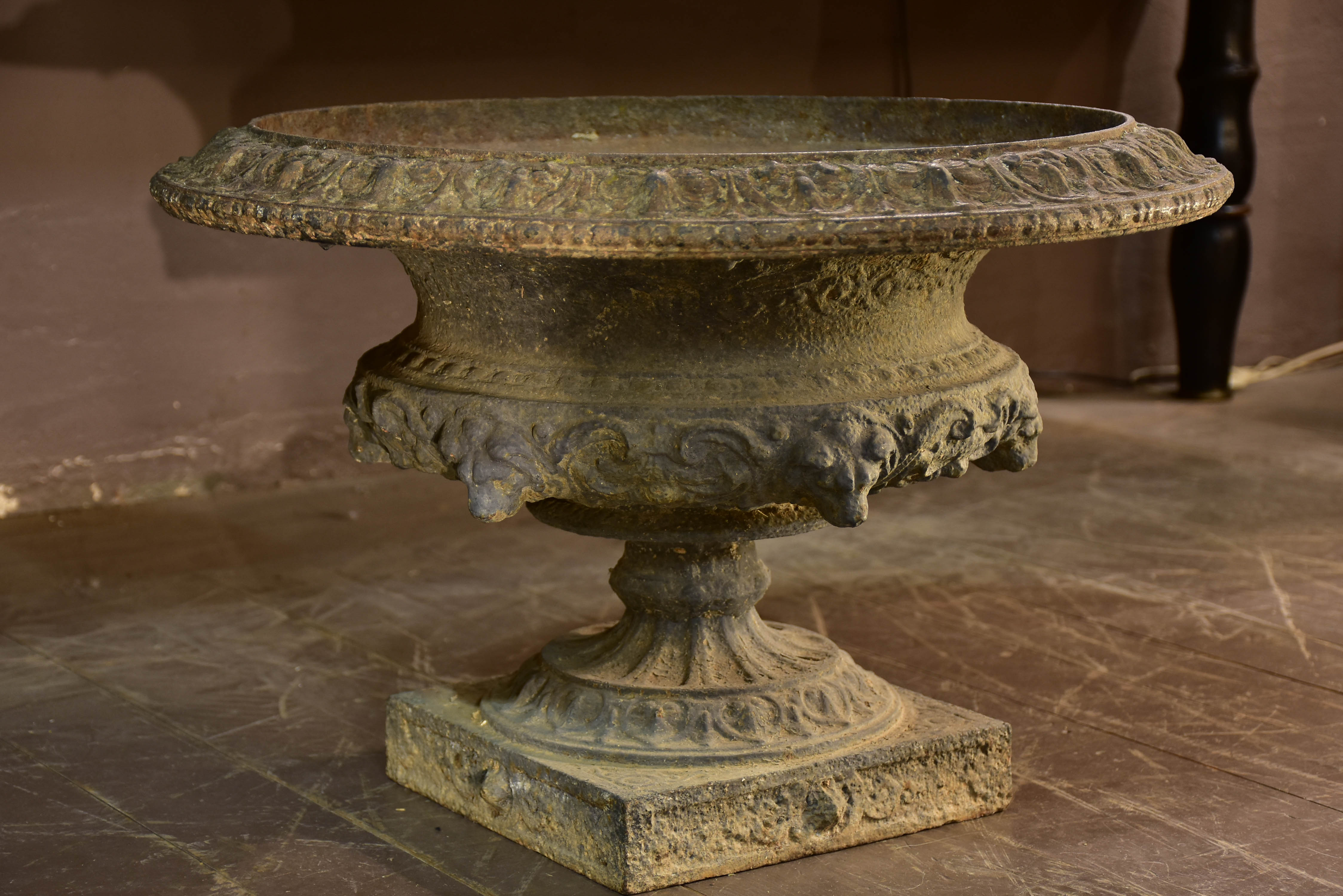 Large grey Medici urn with lions heads