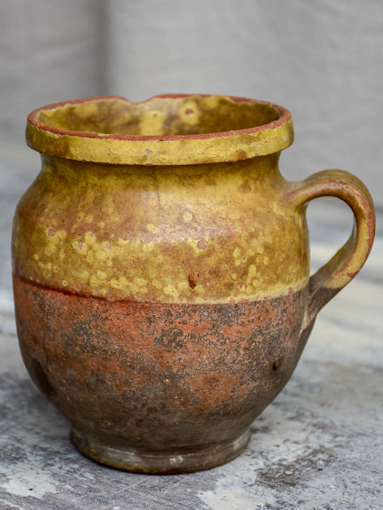 Antique French cup with yellow glaze
