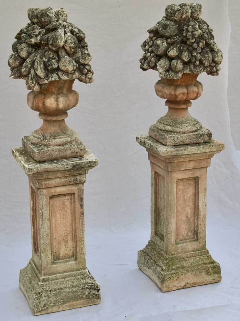 Pair of French concrete columns with fruit baskets 51""