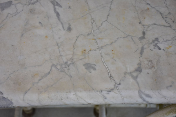 Antique French marble butcher's table with cast iron stand on wheels