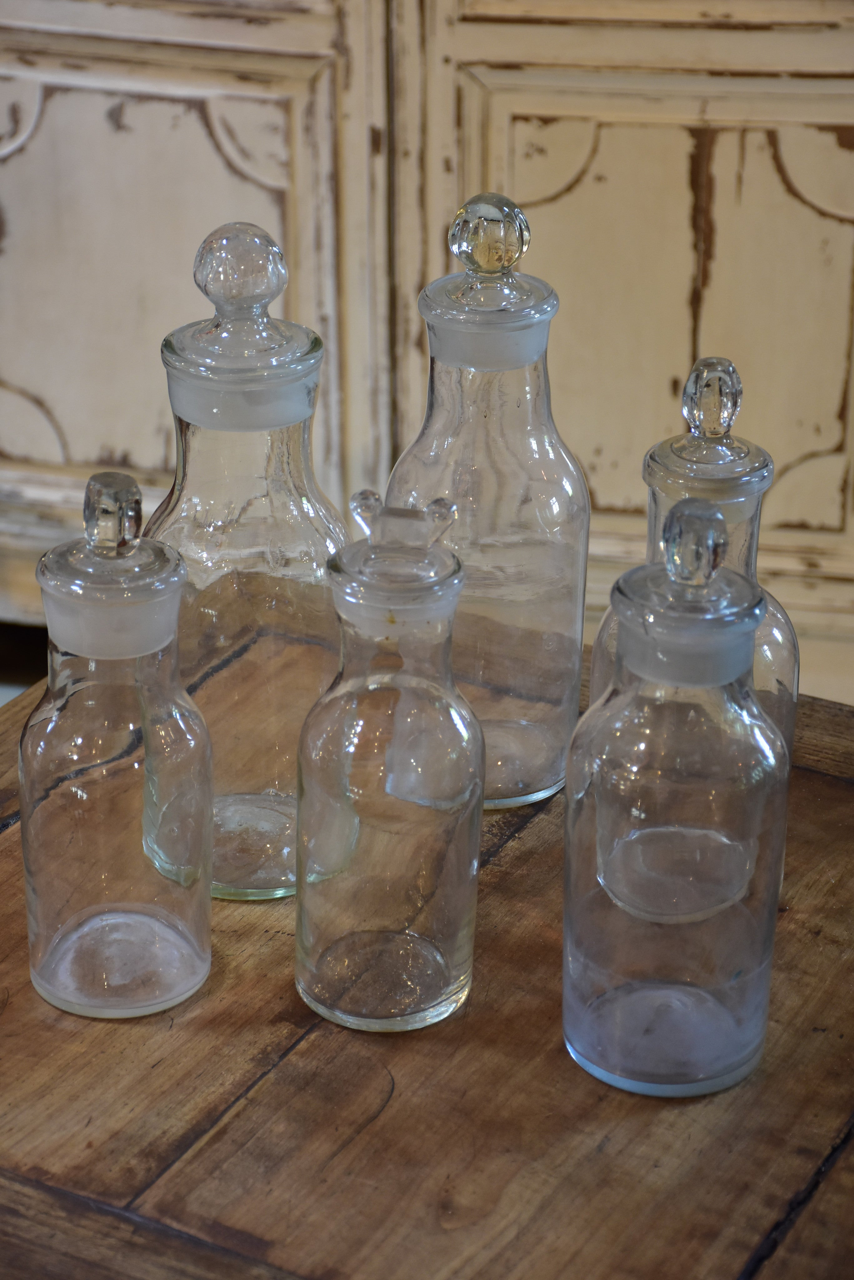 Collection of six antique French bottles with lids