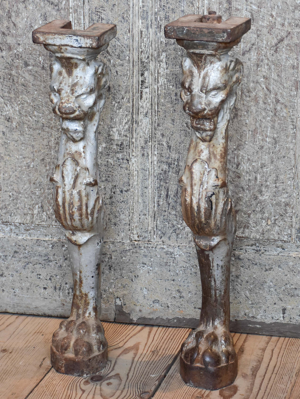 Two console table legs with lion heads and claw feet