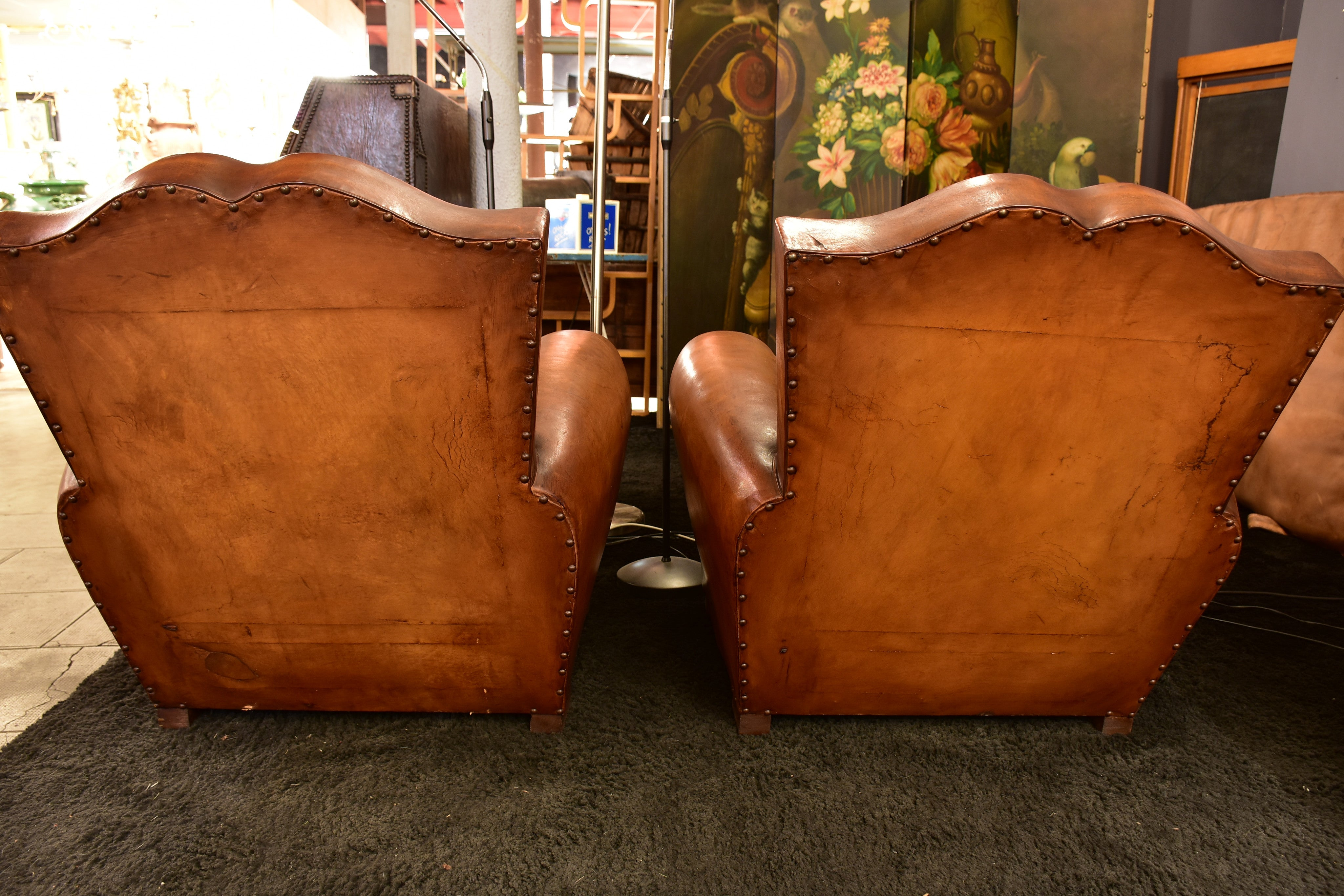 Pair of mustache back vintage French club chairs
