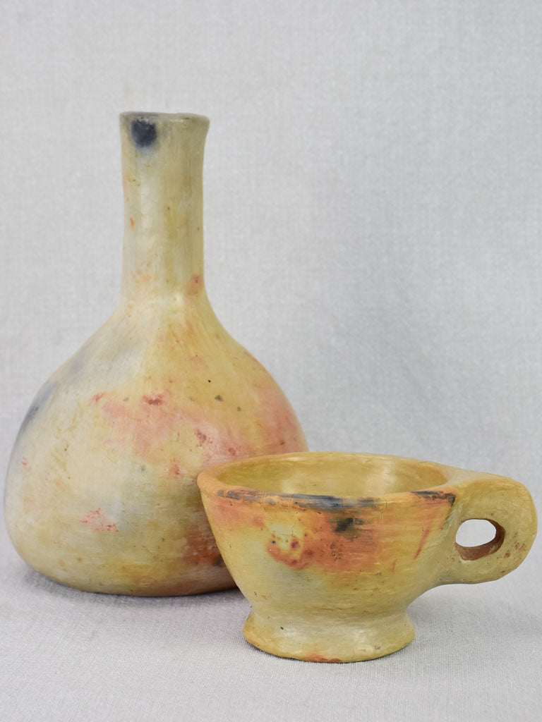 Two artisan-made ceramics made from wood-fired clay - vase and cup