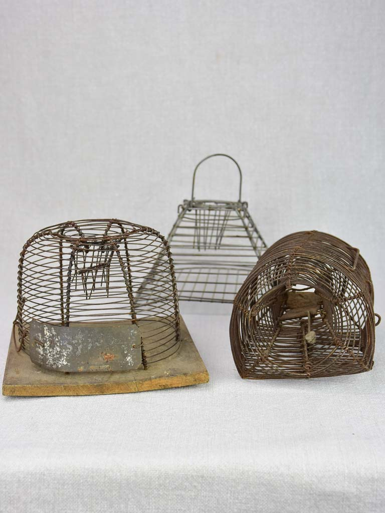Collection of three early 20th century mouse traps