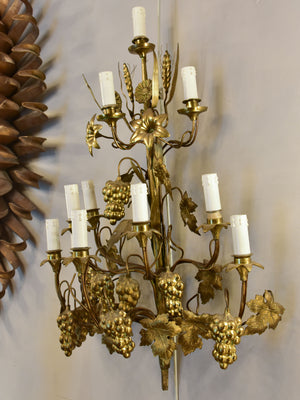 Large pair of gold wall sconces with grapes and vine leaves