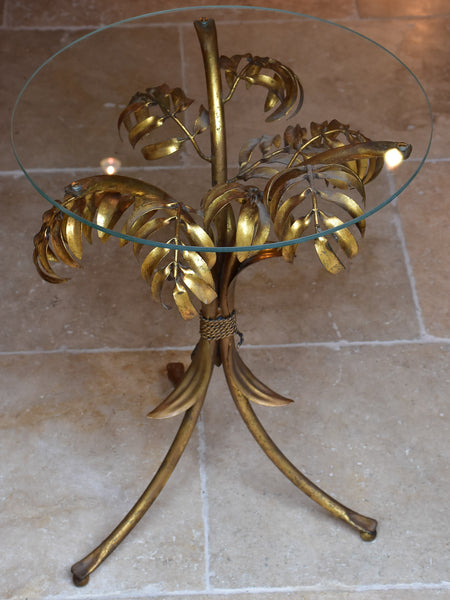 Small round Hans Kögl table with gold palm frond stand