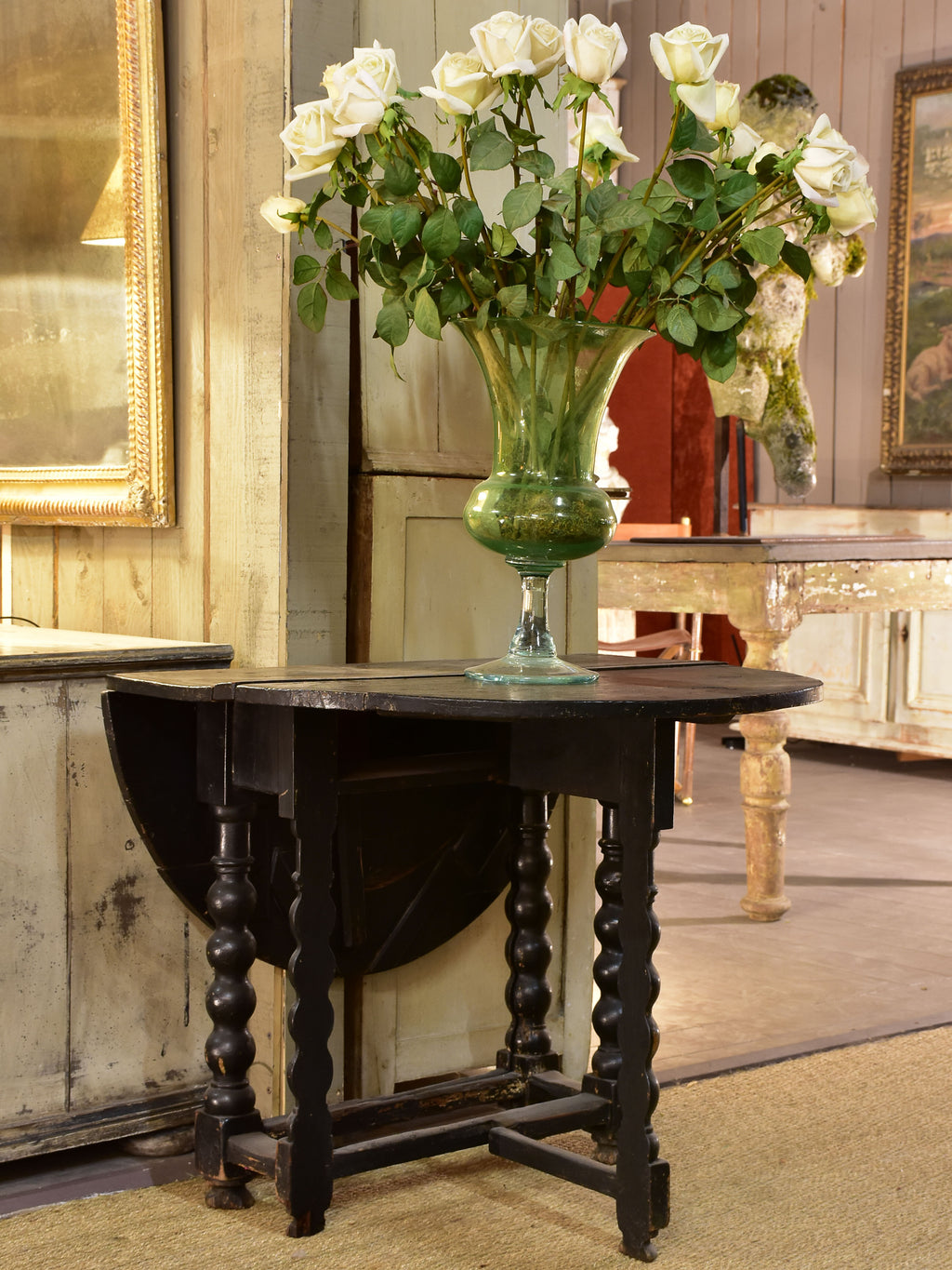 Black drop leaf table Louis XIV