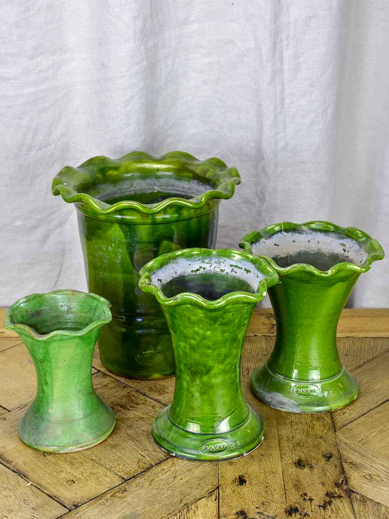 Set of four vintage French florist vases with green glaze and rippled necks