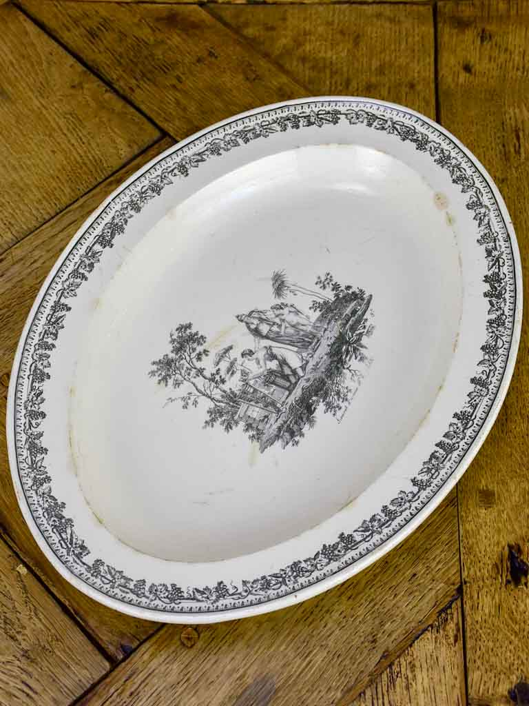 Oval faience platter with mythological scene - Creil