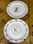 Pair of faience plates from Paris with profile portraits