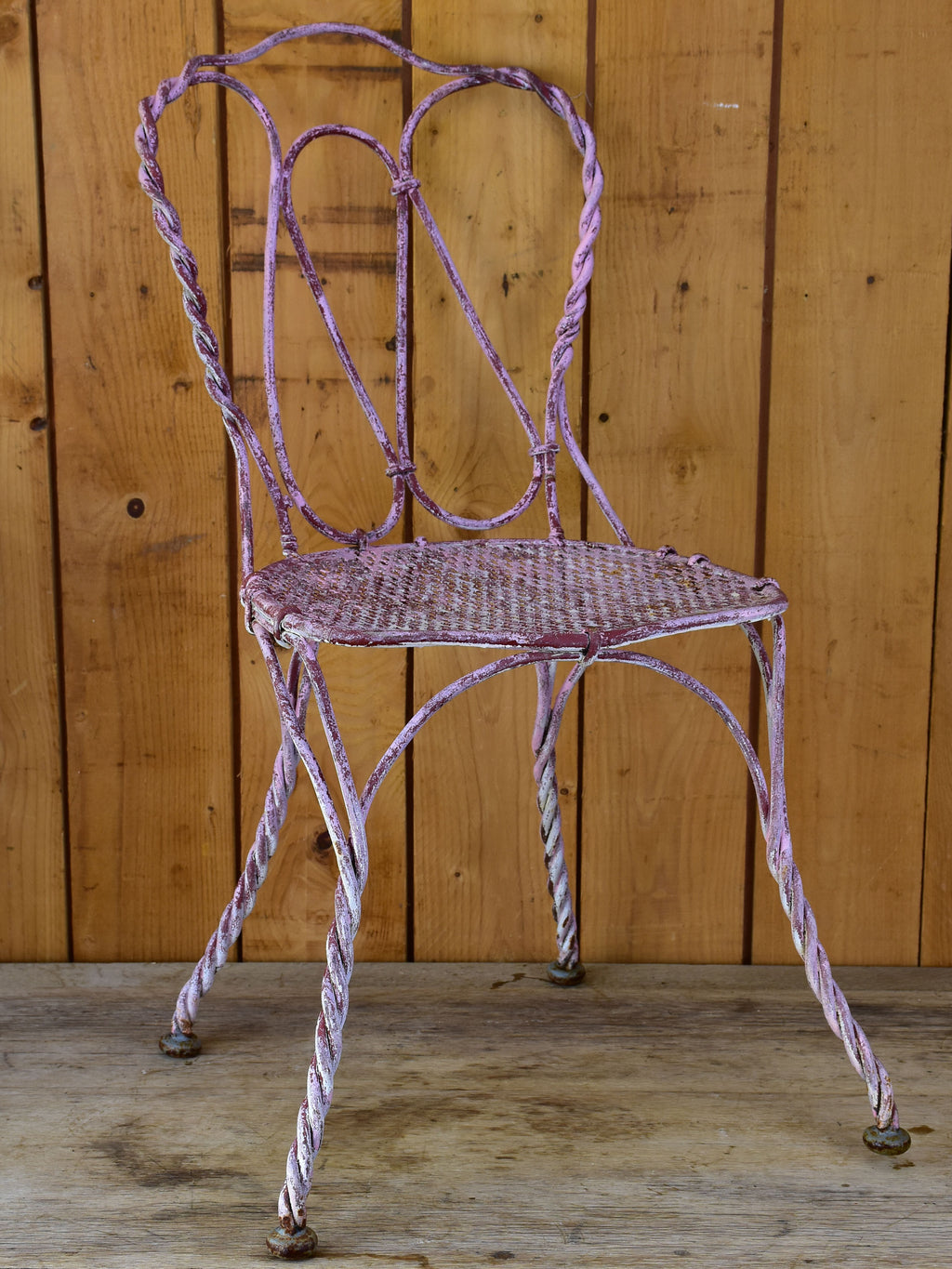 Charming antique French garden chair with pink patina