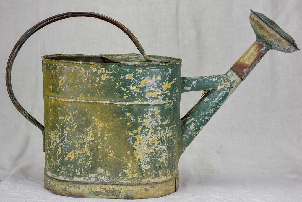 Antique French watering can with green patina