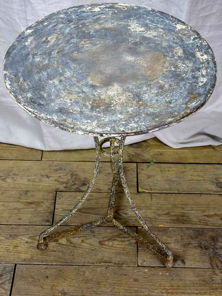 Antique French bistro table with timeworn beige patina