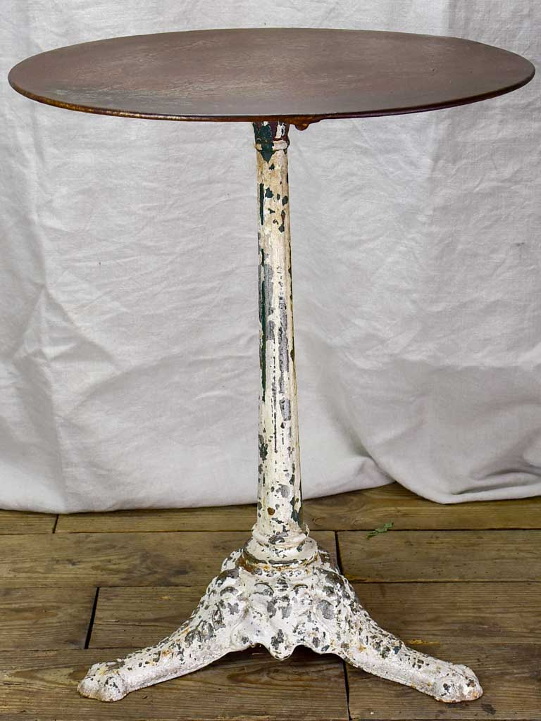 19th Century French bistro table with white cast iron base