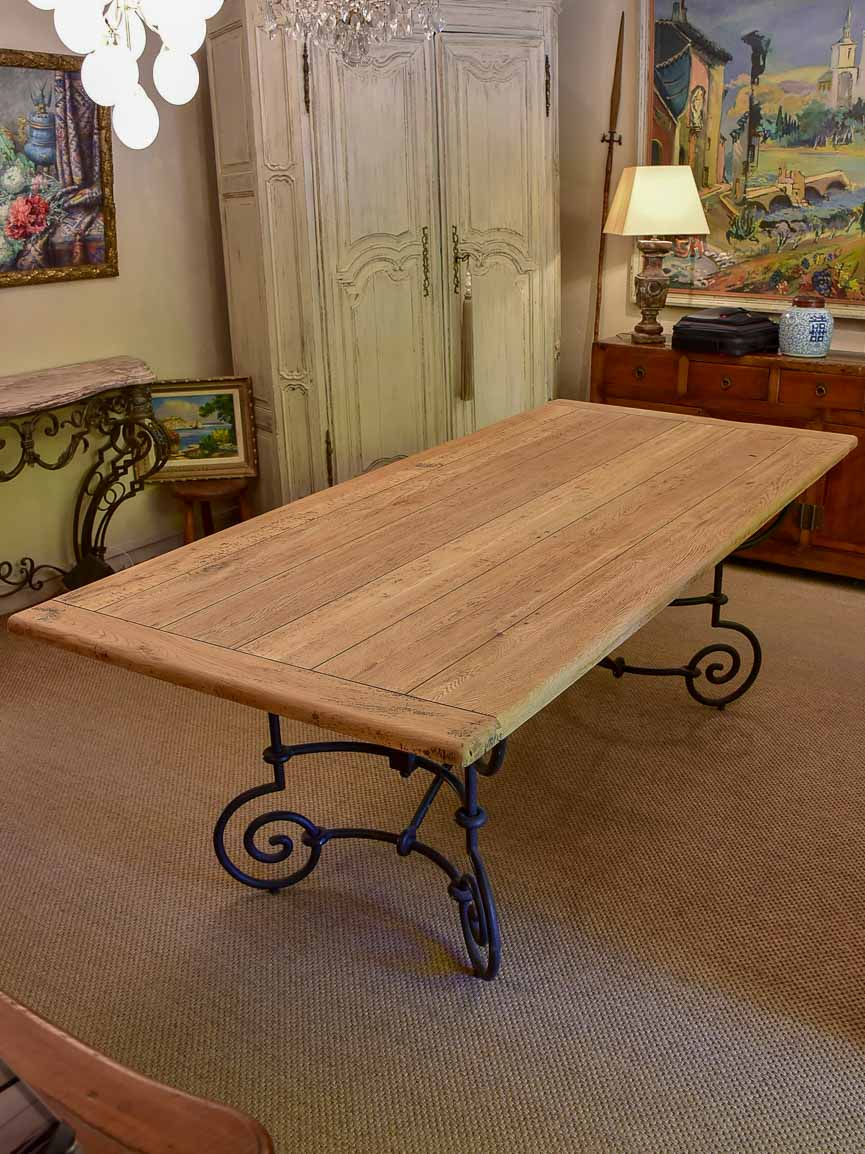 Antique French oak dining table with iron base
