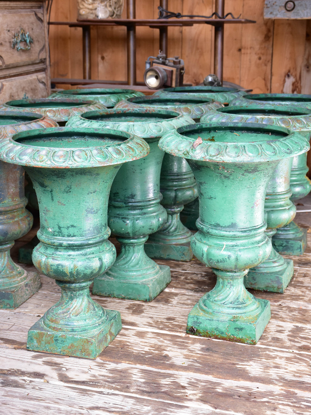 Rare collection of 8 Medici urns with green patina