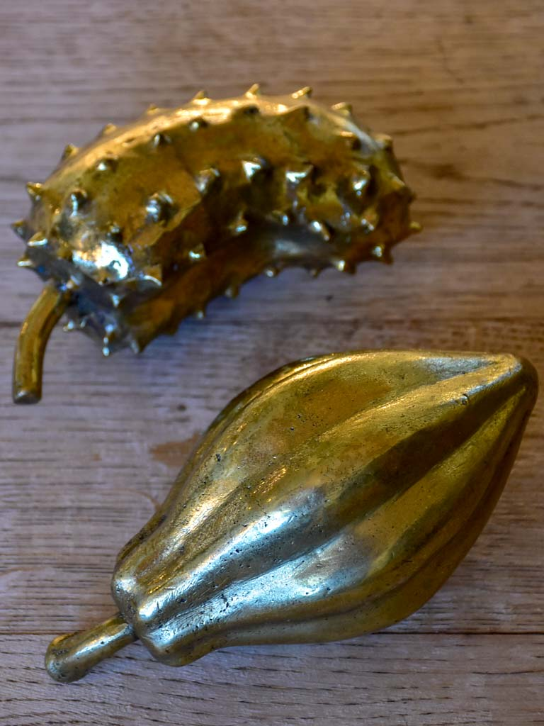 Two bronze mid-century fruit sculptures