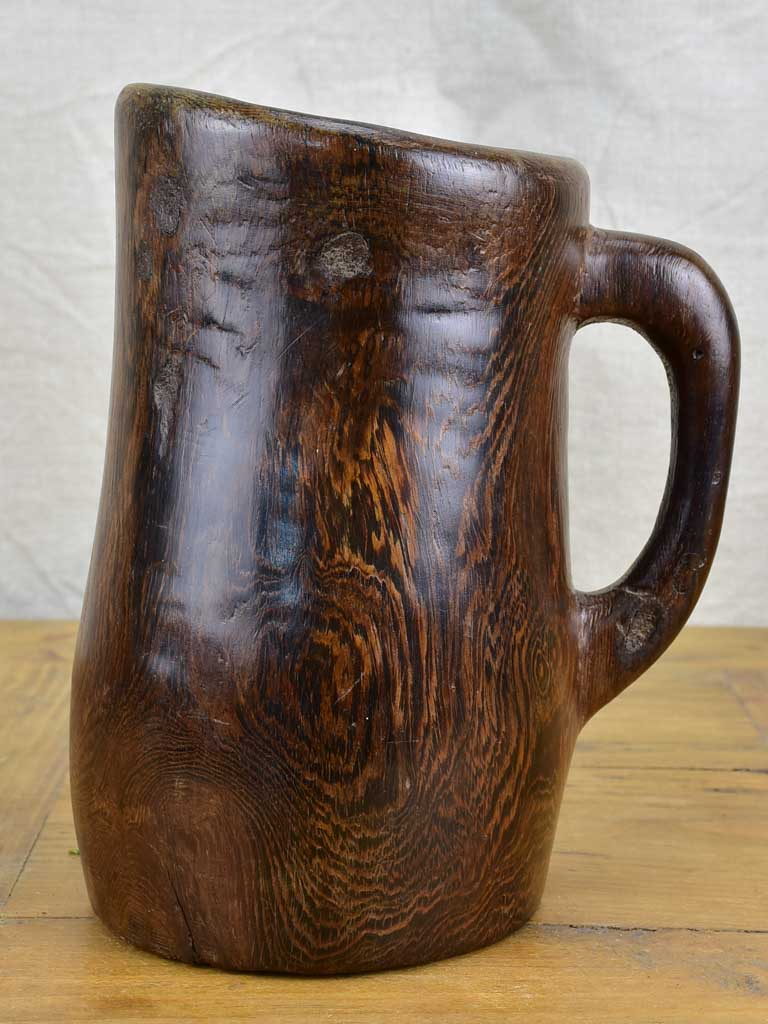 Primitive carved wooden pitcher