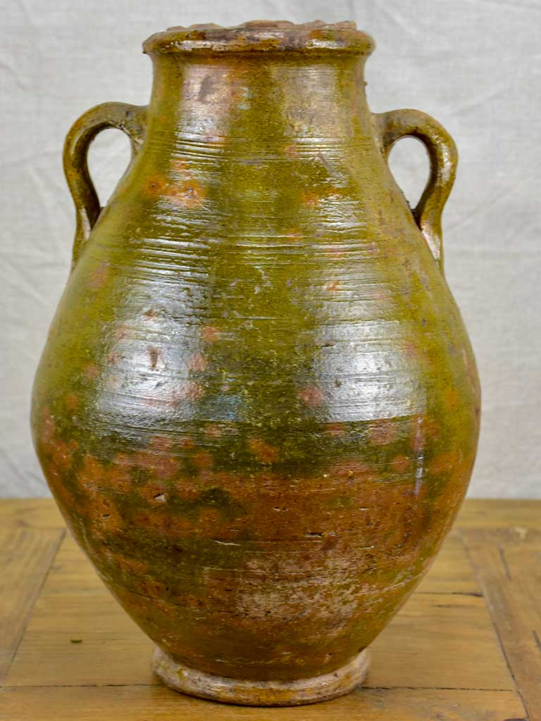 Antique terracotta pot with lid and green glaze