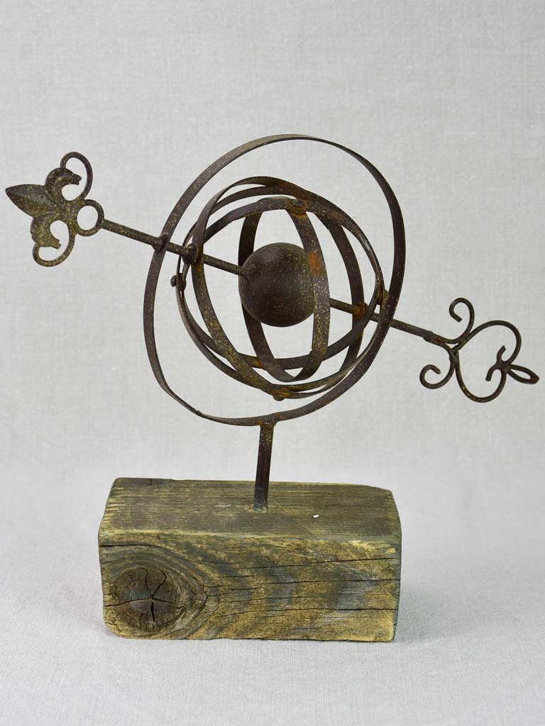 Rustic Armillary sphere mounted on a wooden block