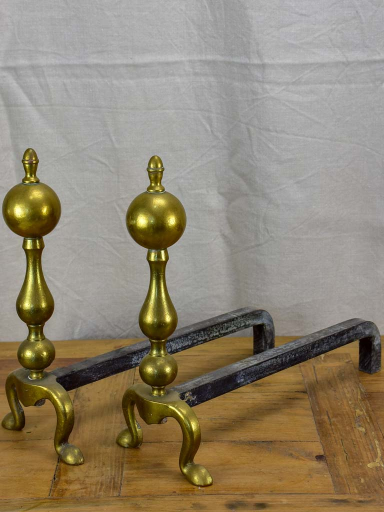 Pair of antique French andirons in brass and iron