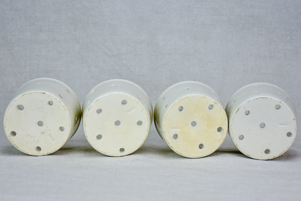 Collection of four white cheese molds #1