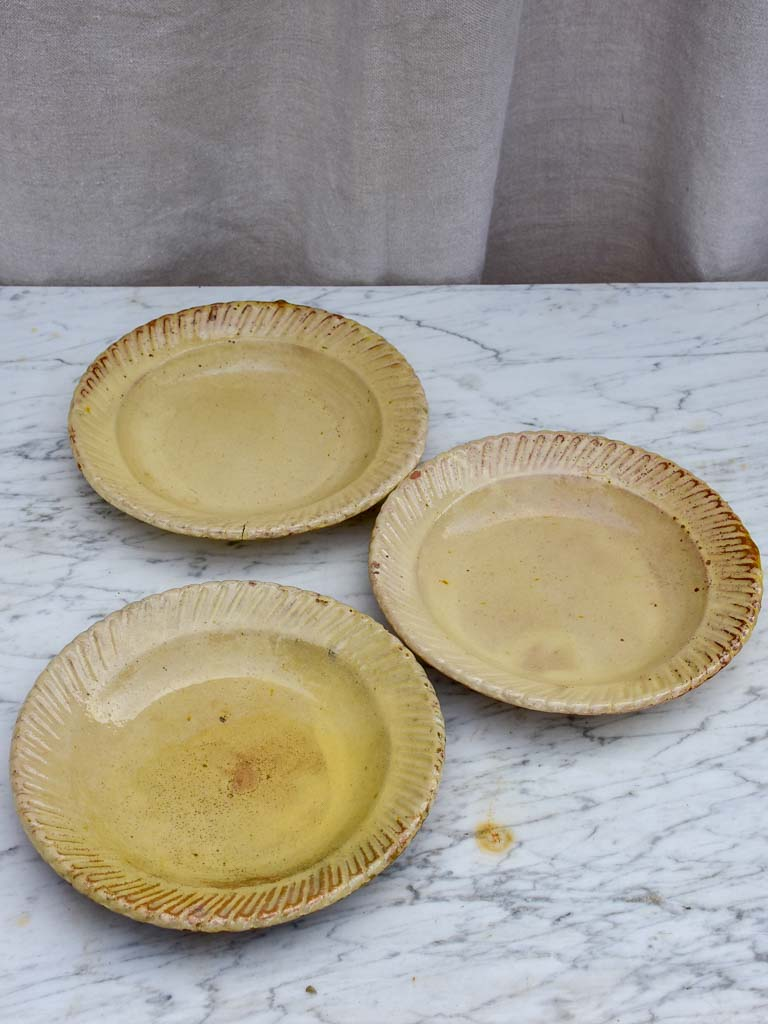 Three antique French yellow ware plates with pretty border