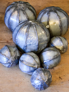 Collection of vintage decorative balls in zinc