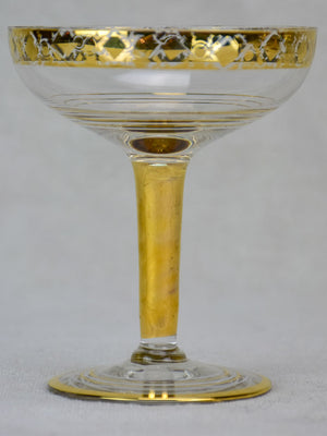 Six French champagne cups with gold decoration
